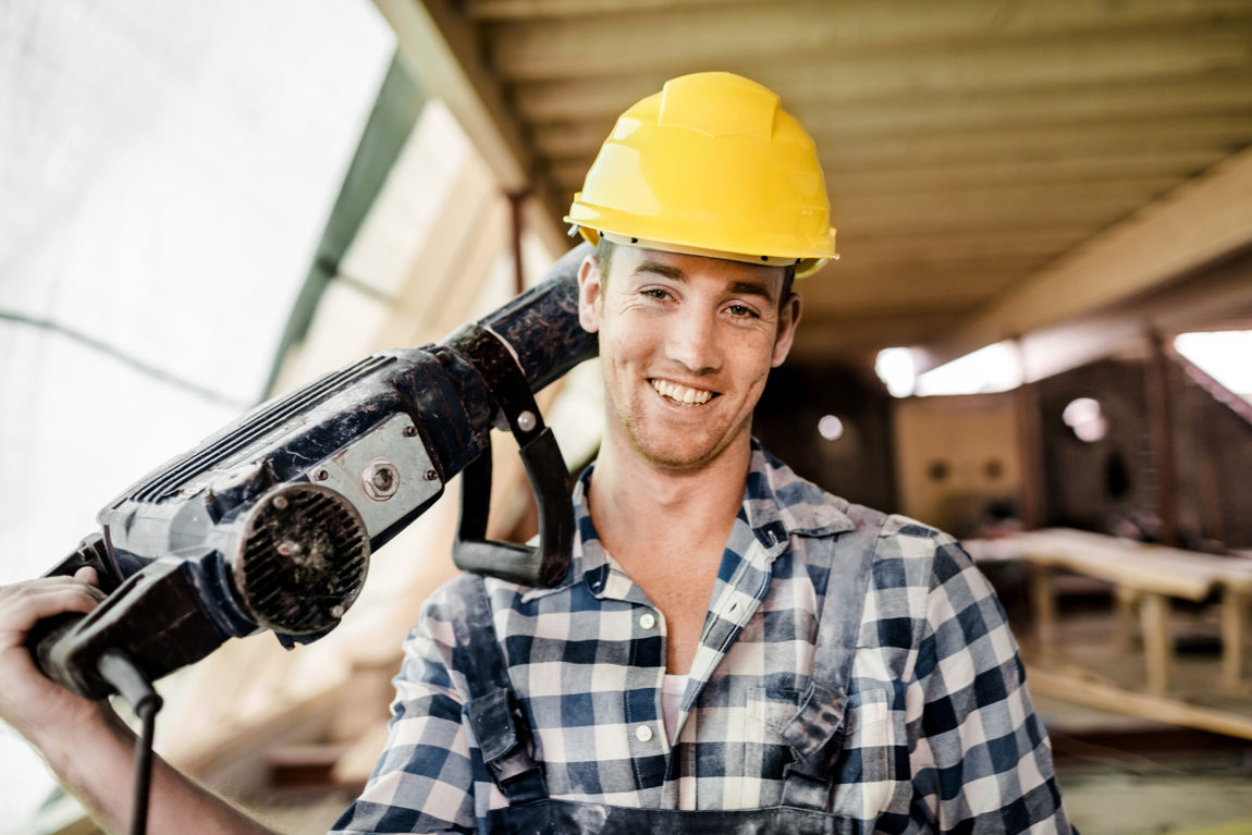 Construction Worker Carrying Jackhammer
