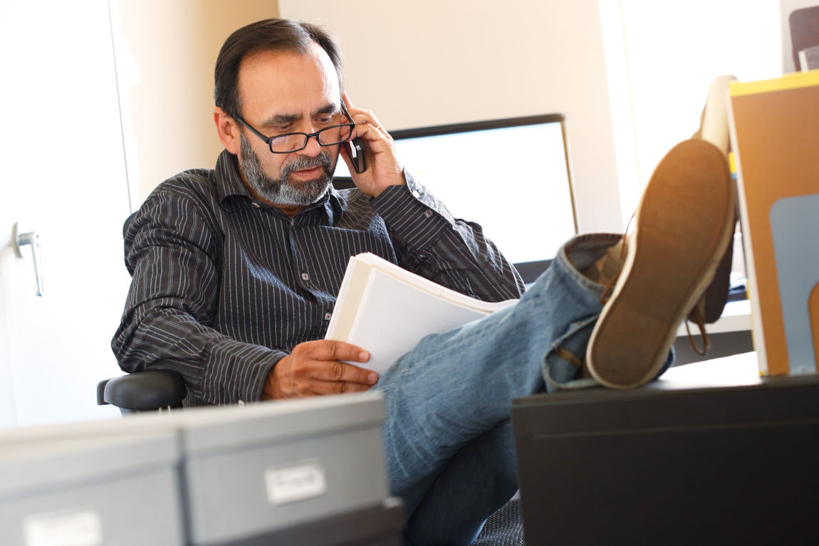 Hispanic Businessman On The Phone With A Client