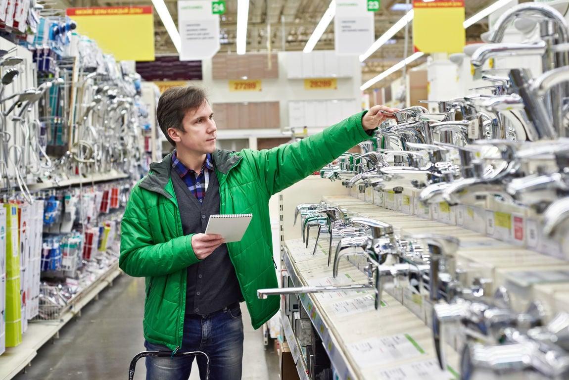 Man shopping for bathroom equipment in shop