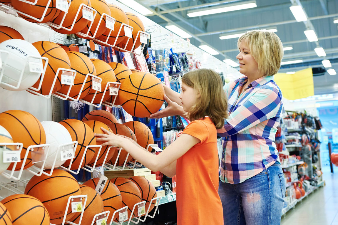 Mother and daughter shopping basketball ball