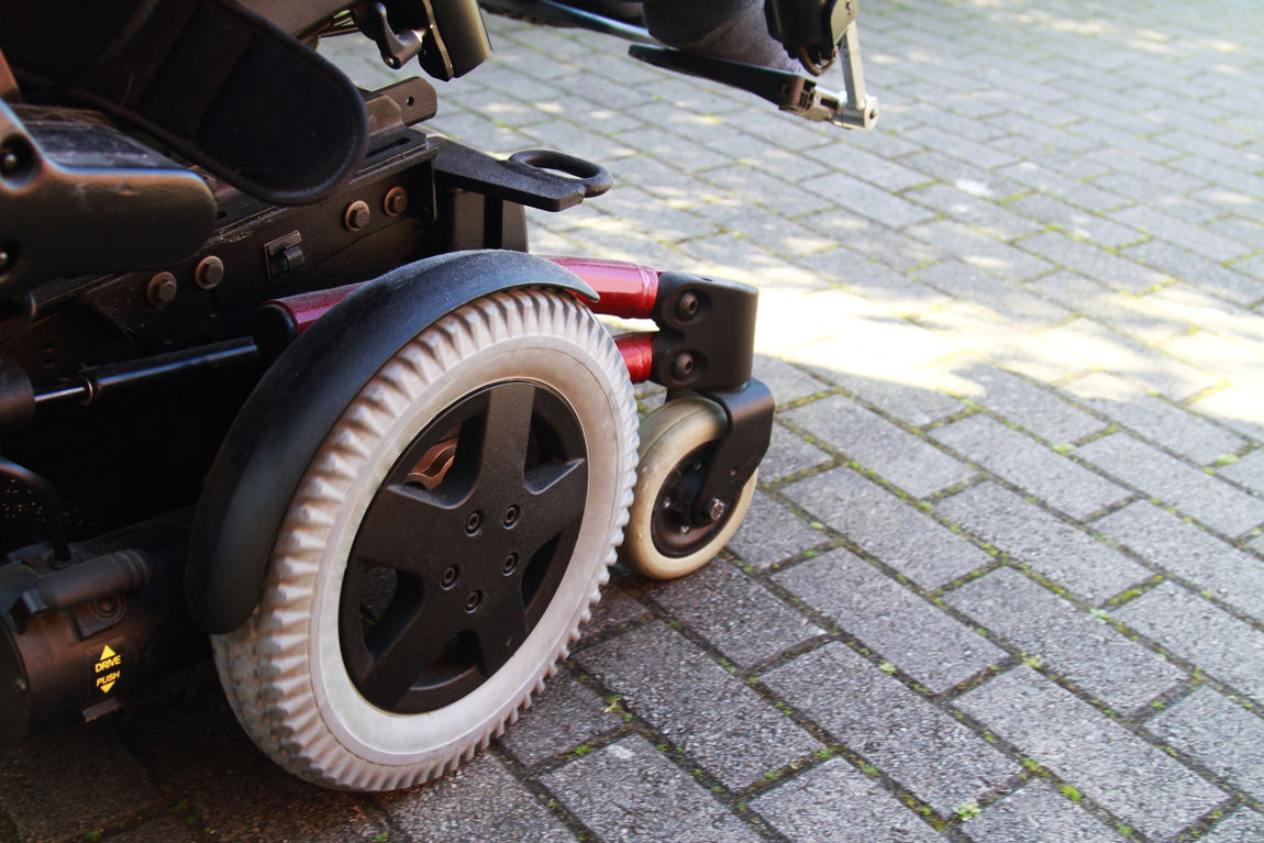 side view of electric wheelchair on pavement